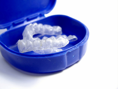 Teeth whitening trays in a blue case